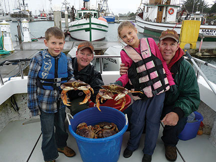 people holding crab